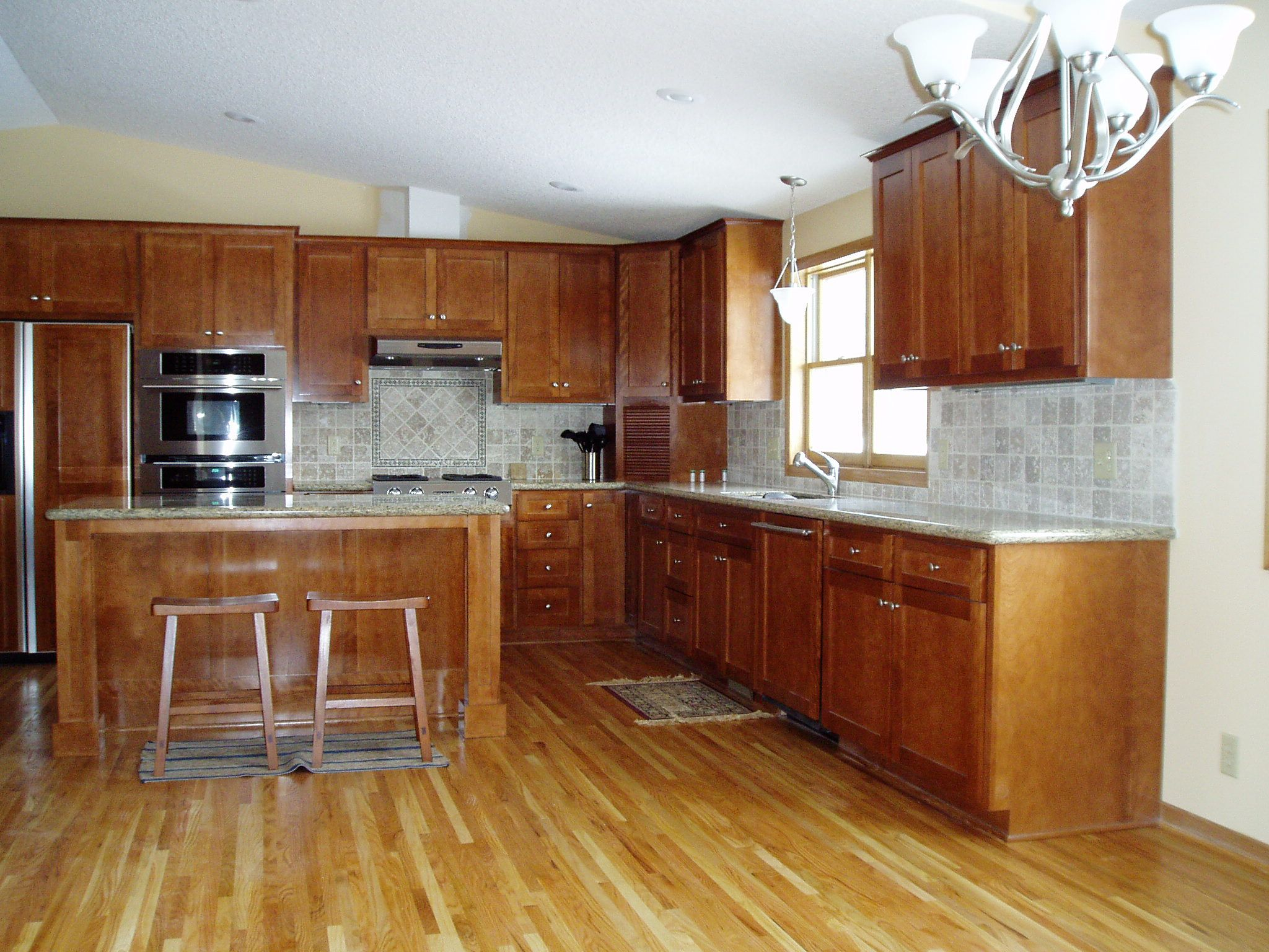 Wooden Floors For Kitchens Wood Flooring That Goes Well With Honey Oak Cabinets Dream Home
