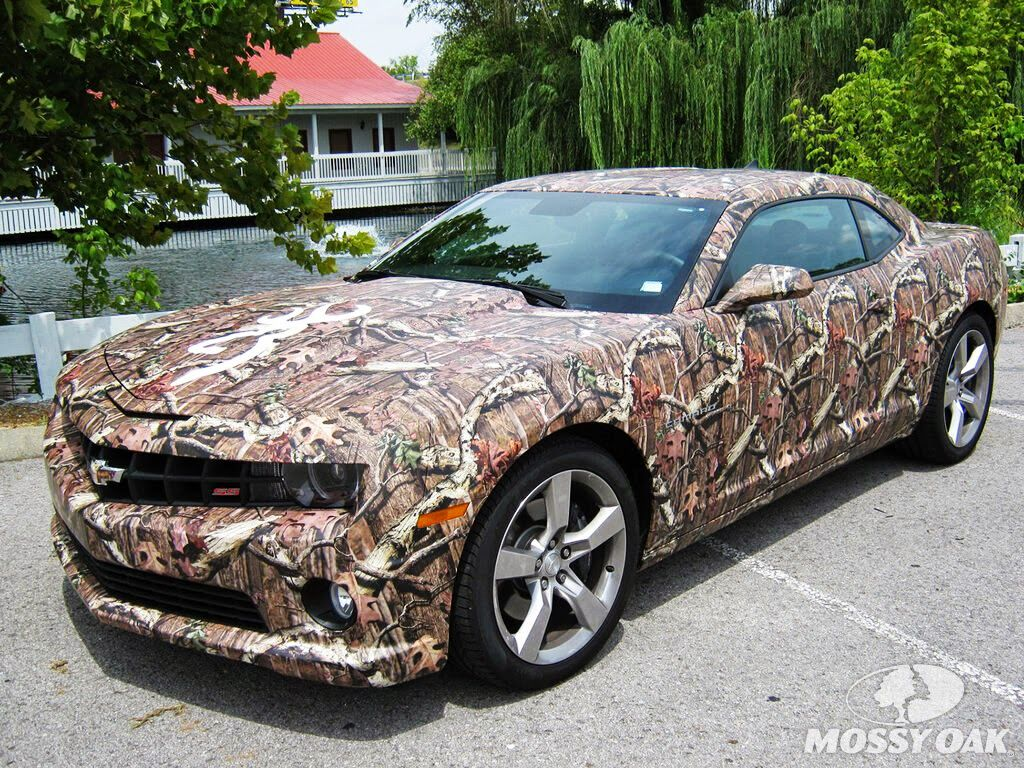 Kristy lee cook s camaro is covered in mossy oak break up infinity to cover