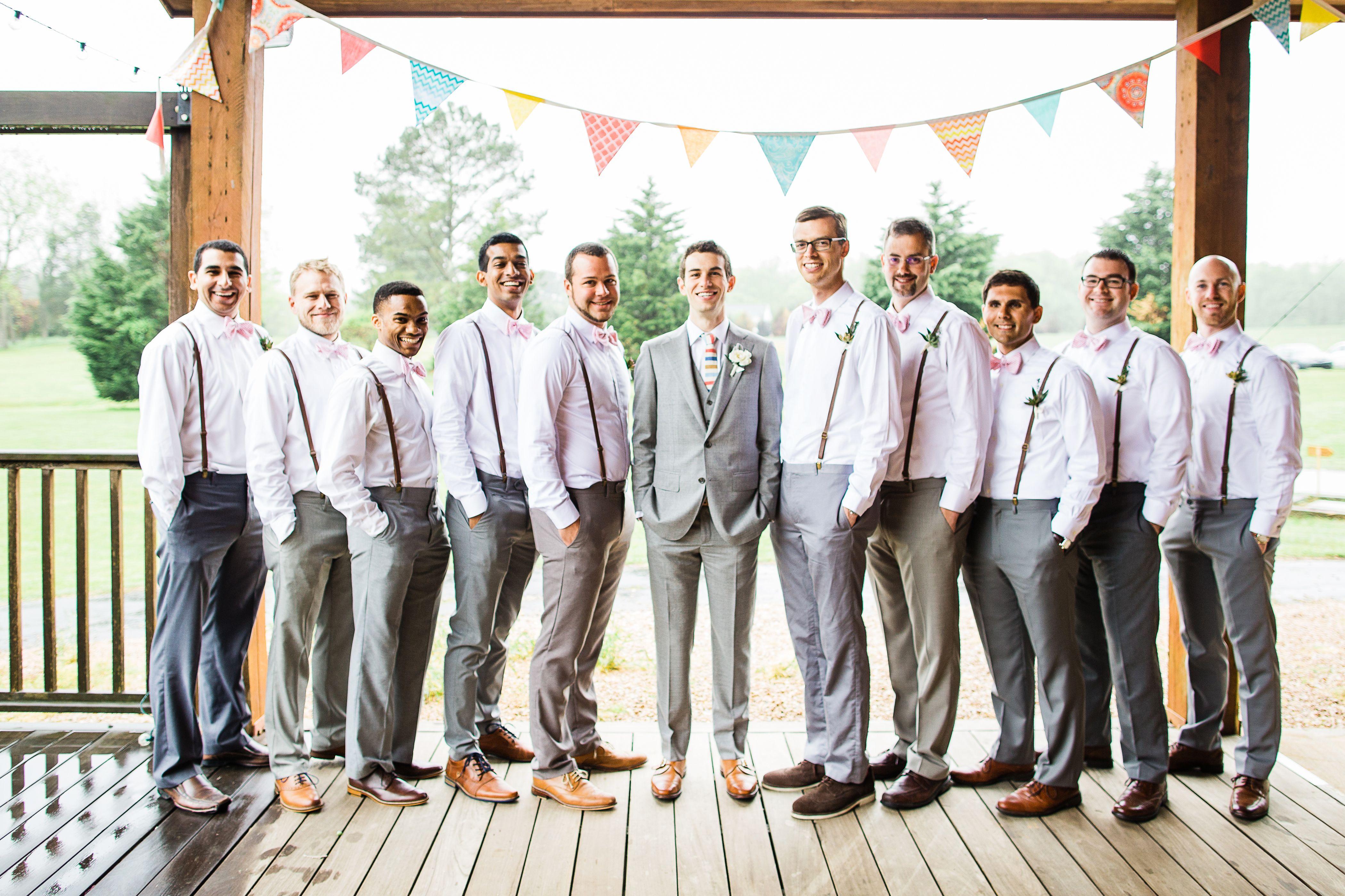 gray pants leather suspenders groomsmen attire