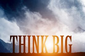 image of motivation  - THINK BIG text on mountains landscape at sunset dramatic sky - JPG