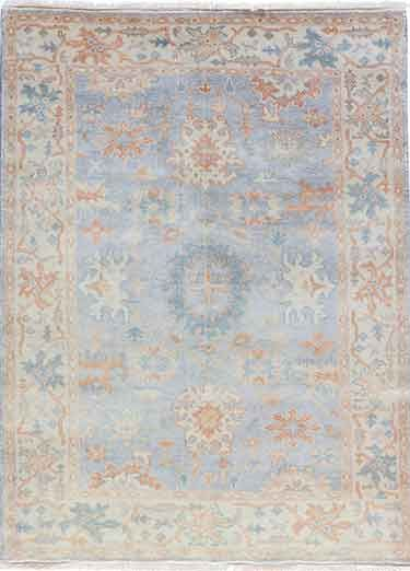 Washed Jewel Tone Motifs On Soft Oatmeal Ground Gives The Cardamon Collection An Easy Elegance Inspired From Vin With Images Area Rug Collections Rugs Area Rugs