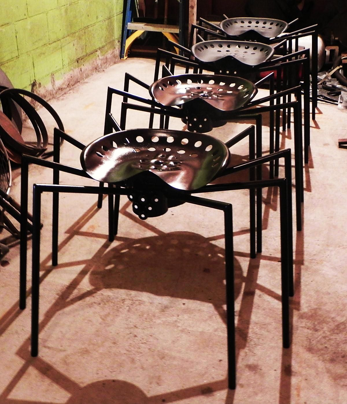 Metal spider chairs made with antique tractor seats they for Wire yard art