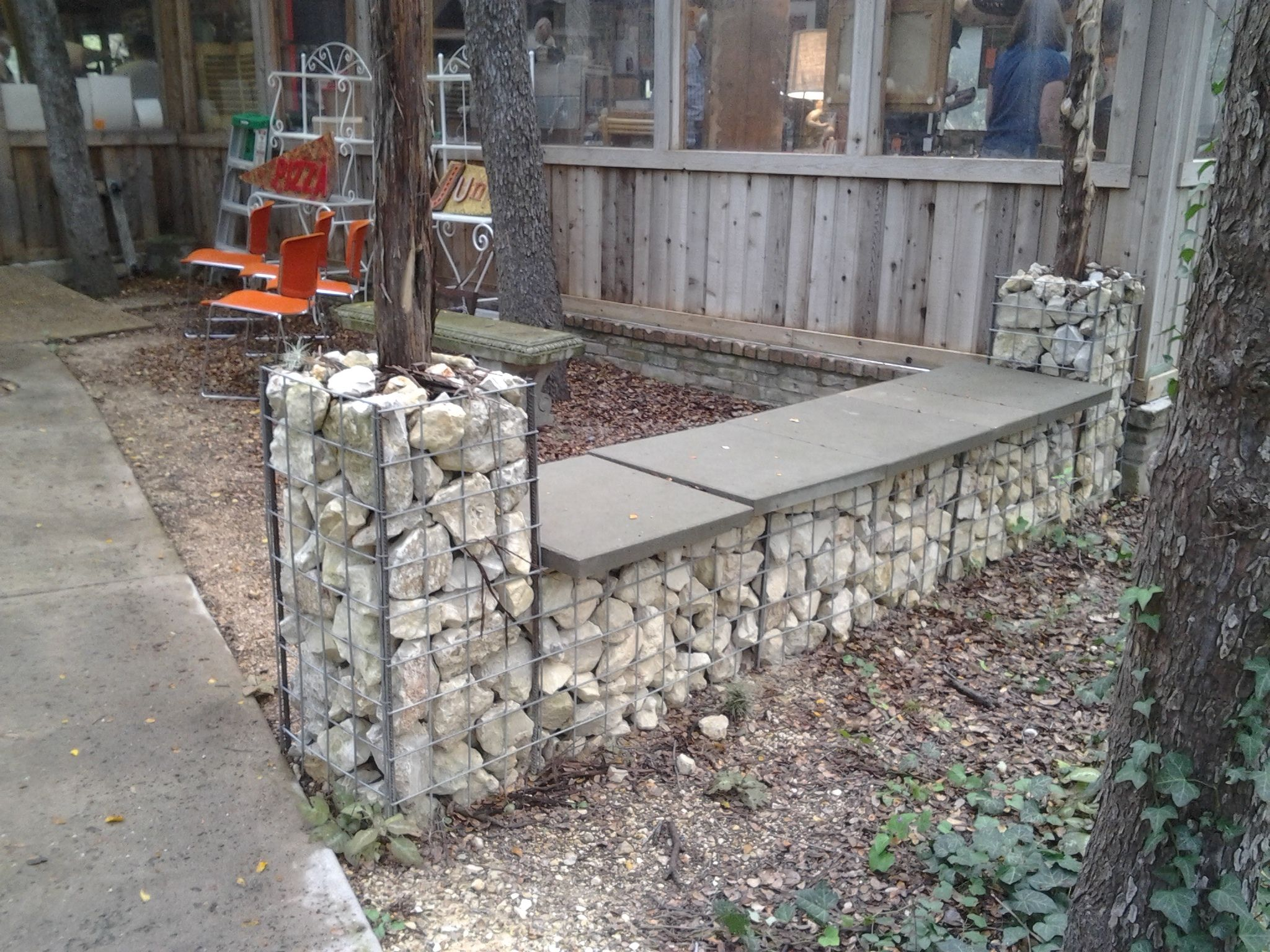 Gabion basket with rocks as walla and bench. Easy to make.