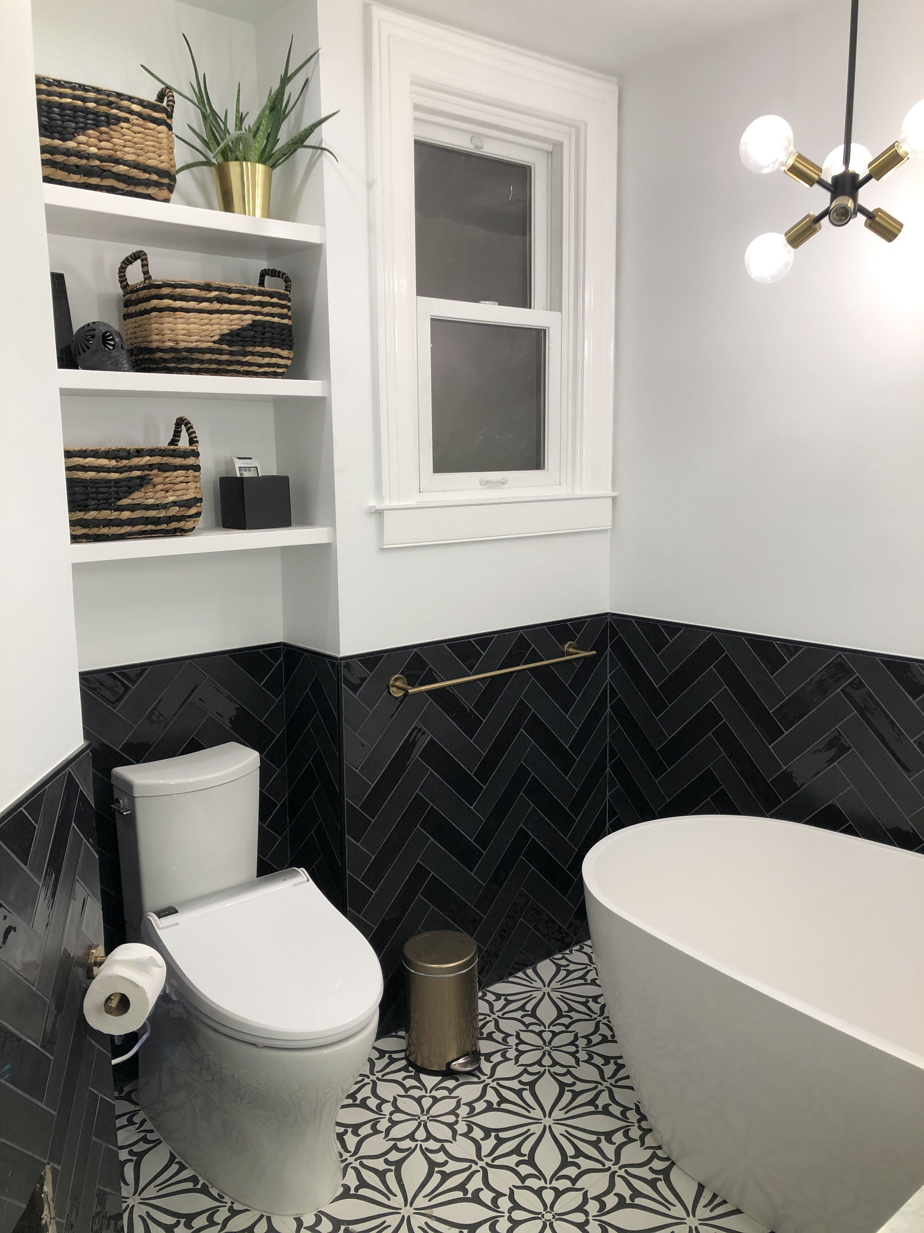 Black And White Bathroom With Champagne Bronze Fixtures Alternating Matte And Glossy Black Tiles White Bathroom Small Country Bathrooms Modern Small Bathrooms
