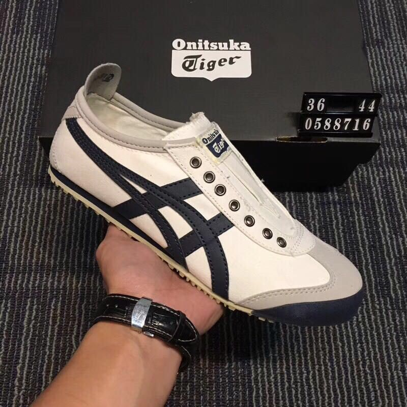 uk availability 0cfff eaa00 Onitsuka Tiger Beige Dark Blue Slip-on Canvas Shoes ...