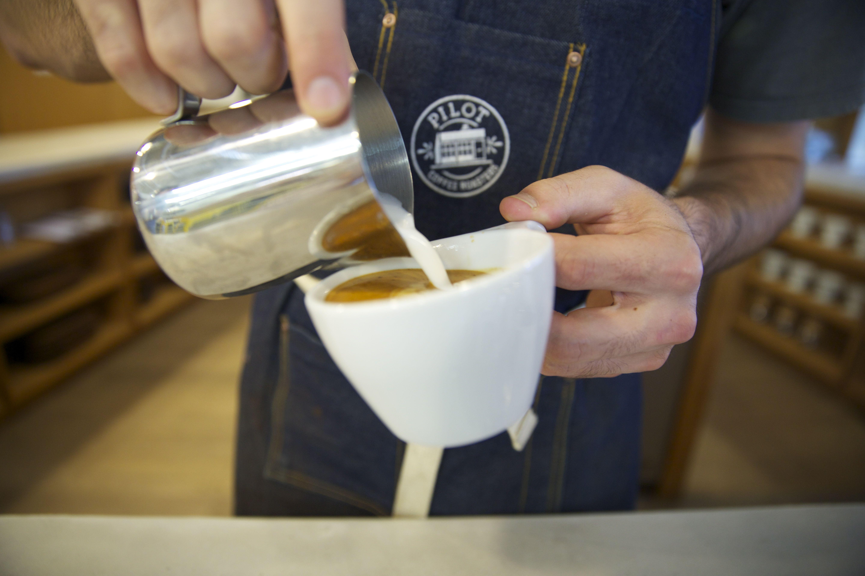 The Tasting Bar. Latte art. Barista. Apron. Espresso. Pilot Coffee Roasters | Toronto | Canada