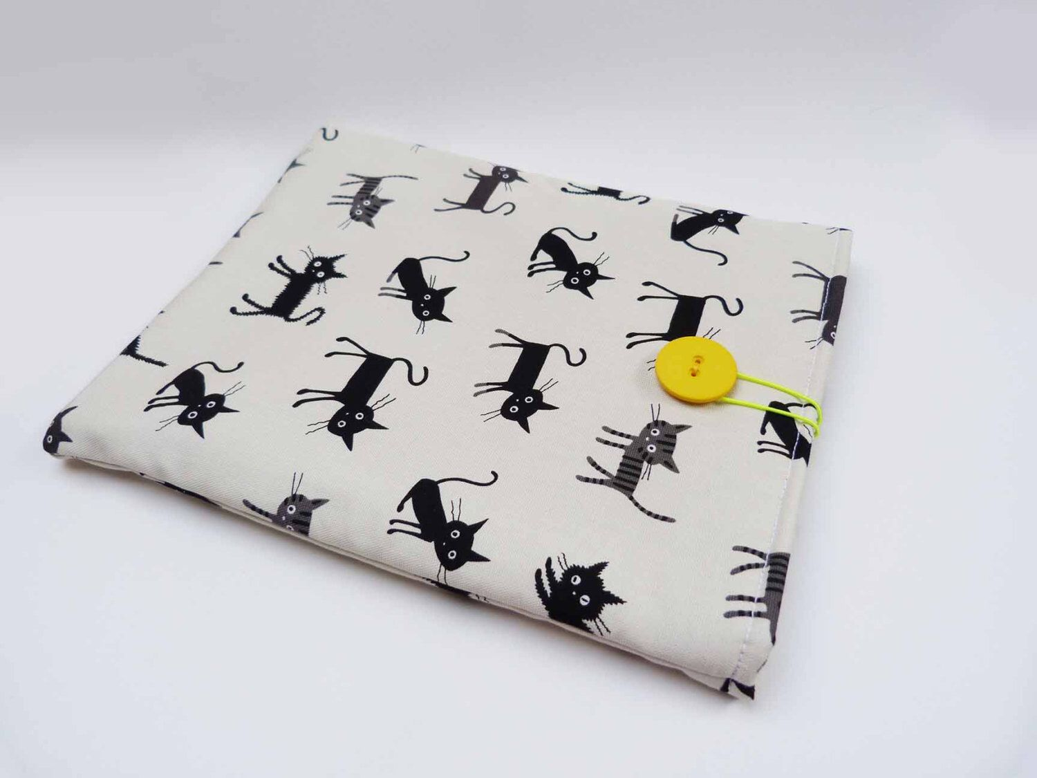 Black and white cat fabric iPad sleeve by cheekyleopard on Etsy https://www.etsy.com/listing/212556498/black-and-white-cat-fabric-ipad-sleeve