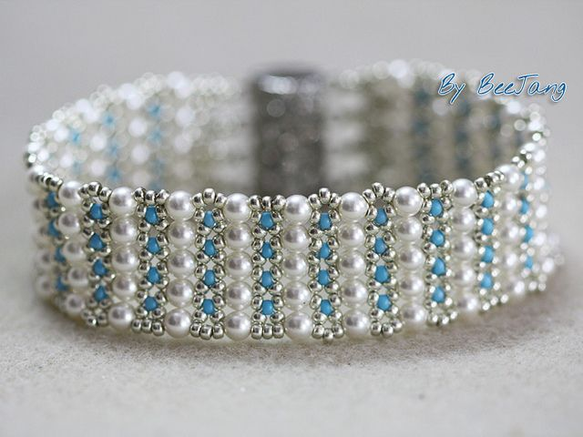 """Designed by Sonoko Nozue, from the book """"Japanese Beadwork with Sonoko Nozue"""". She used Swarovski white pearls and Miyuiki seed beads. The technique is simple netting. Very easy"""