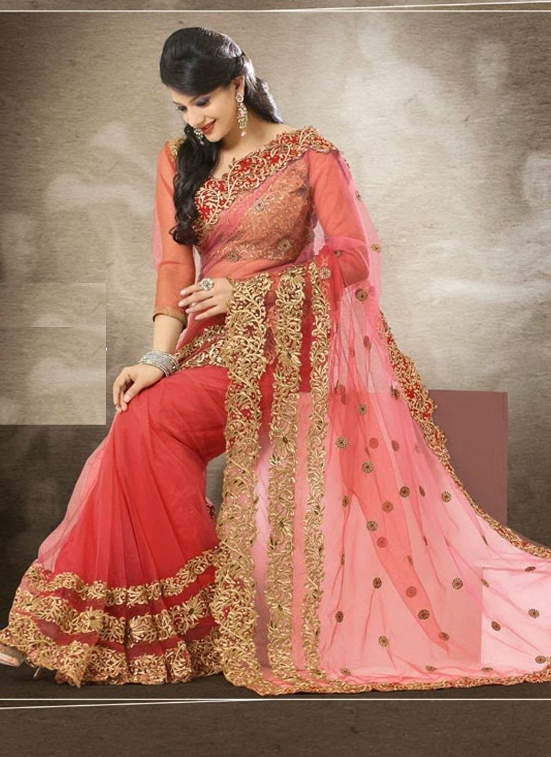 Peach color saree for wedding designer clothes to celebrate the festival choose from our best