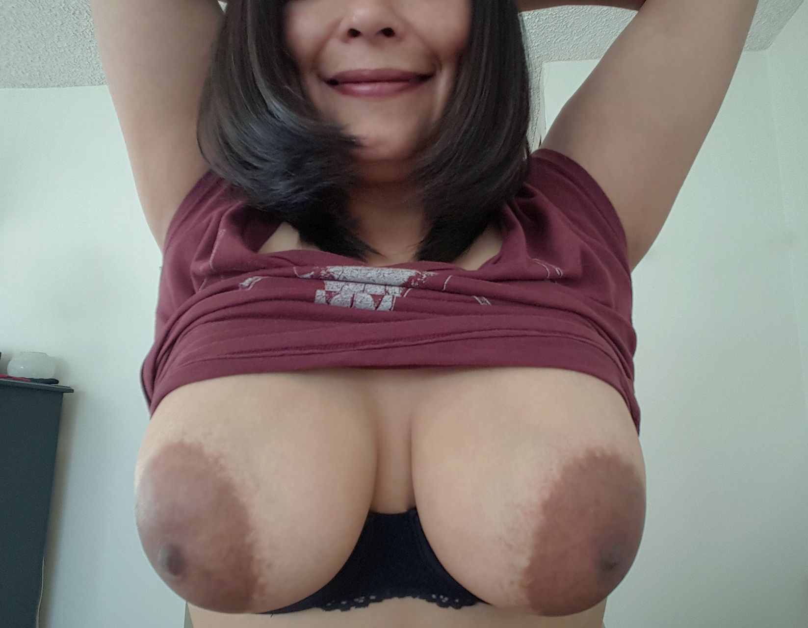 hot busty latina wife, shamelessly exposing her big boobs and dark