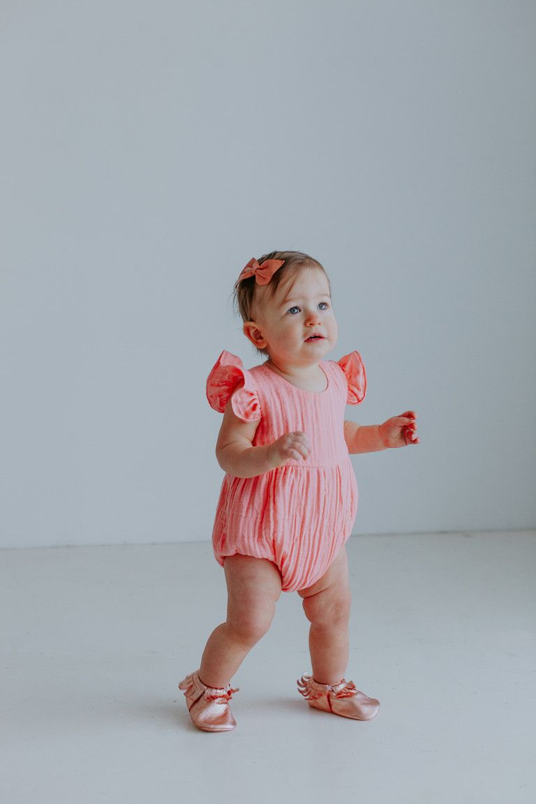 982a91ba9 Our Favorite First Birthday Photoshoot Outfit Picks // pink bubble romper  from cuteheads.com