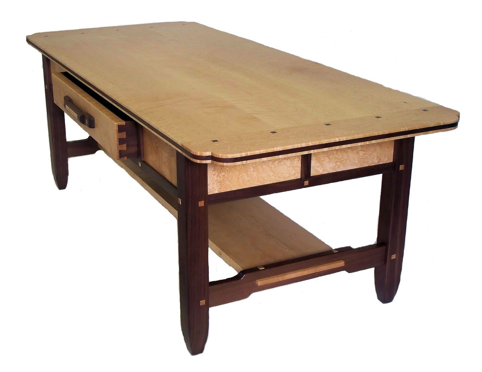 A birdseye maple and walnut coffee table made by brian