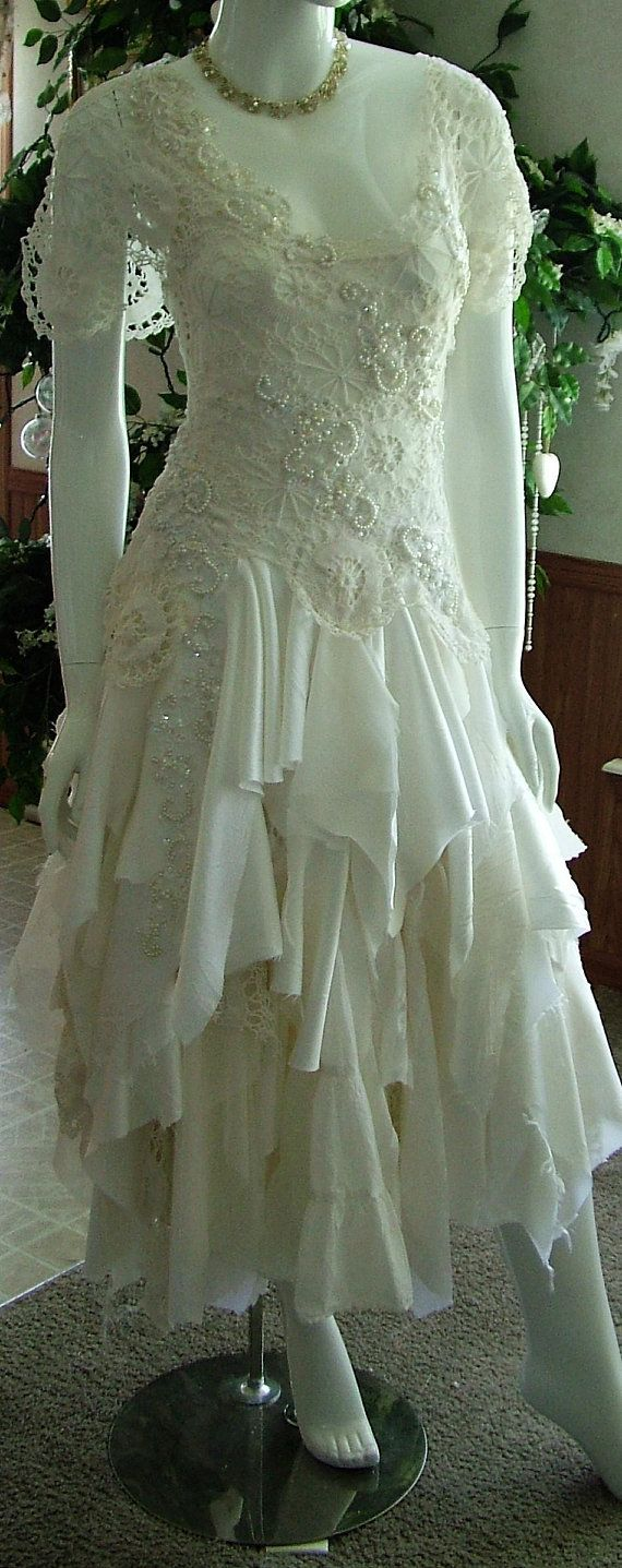 One of a kind wedding dresses  Cream off white tattered wedding dress one of a kind lots of wedding