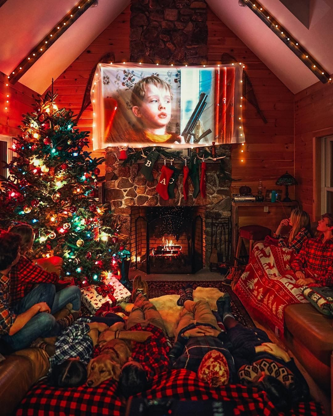 Count The Number Of People Cuddled Up Watching The Movie Cozy Christmas Christmas Wallpaper Christmas Lights