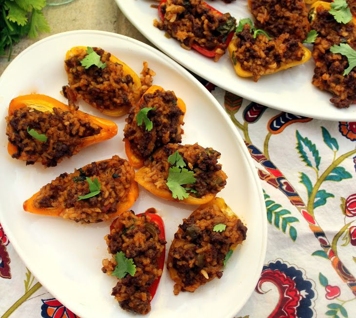 Mini Mexican Style Stuffed Peppers Recipe with instant white rice, water, ground beef, taco seasoning, beef broth, salsa, cilantro, Mexican cheese, sweet mini bells