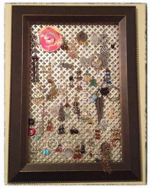 My neighbor made this for me. An earring frame. I have it hanging over my jewelry box. Love it!