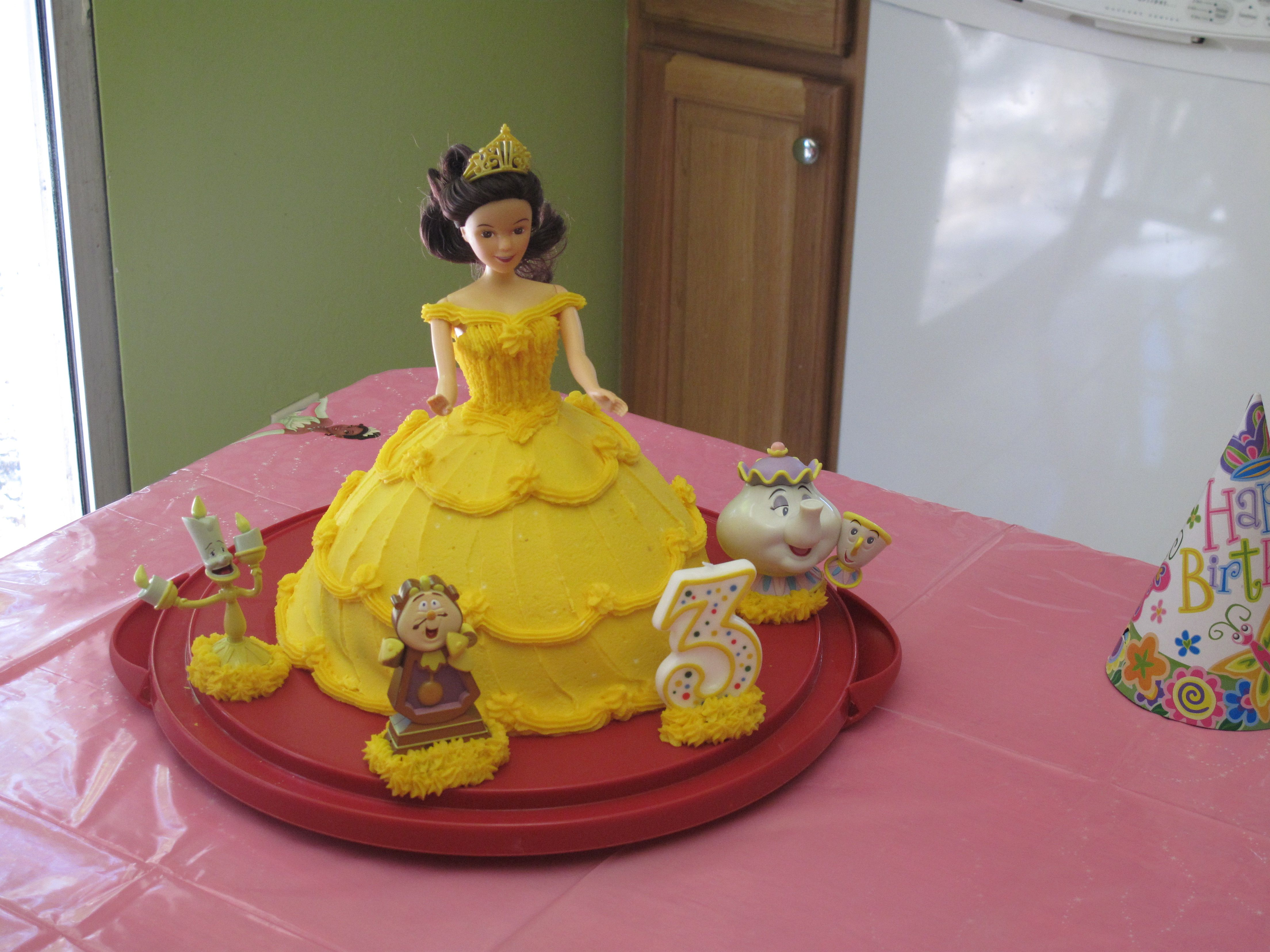 Beautiful Belle cake You can make any princess cake with a Barbie