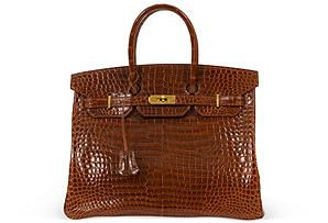 This is my Holy Grail of bags. A croc Birkin. It literally took my breath away when I saw it pop up. Or maybe it was the $69,000 price tag that did it. Either way, it's beyond spectacular.  Hermes Porosus Crocodile Birkin 35  www.onekingslane.com