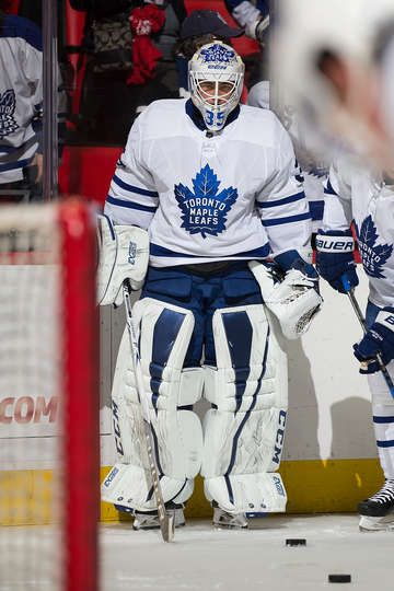 Goaltender Curtis McElhinney #35 of the Toronto Maple Leafs follows the play during warm-ups prior to an NHL game against the Detroit Red Wings at Little Caesars Arena on December 15, 2017 in Detroit, Michigan