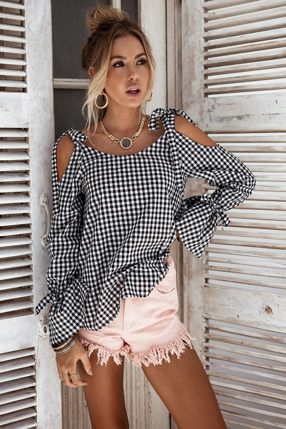 c2c922ac900f4 The super cute Mimi Gingham Top is made from a lightweight cotton fabric in  a black and white gingham print. It is a cold shoulder style and features  ...