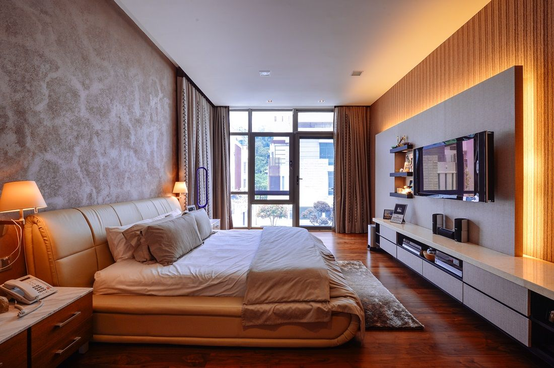 wallpaper adds a distinct character to this master bedroom