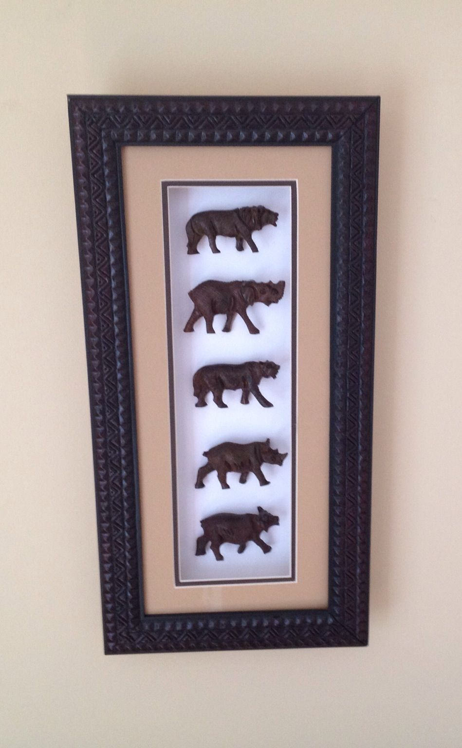 Wood Carvings in Shadow Box Frame - Big 5 Animals: Rustic, Handmade Art. The Big Five are the Lion, the Elephant, the Leopard, the Rhinoceros, and the African Buffalo. This product has beige matting.