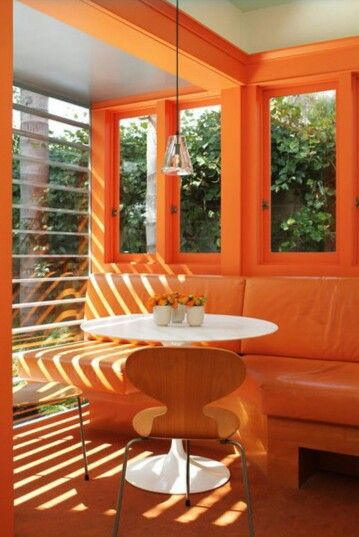 Orange... great cafe scheme. I'd add some purple cushions.