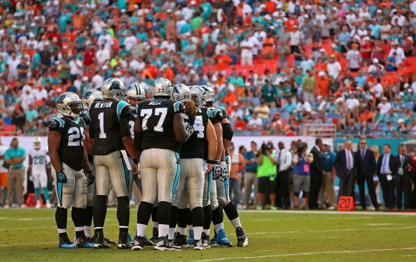 MIAMI GARDENS, FL - NOVEMBER 24: The Carolina Panthers call a play during a game against the Miami Dolphins at Sun Life Stadium on November 24, 2013 in Miami Gardens, Florida. (Photo by Mike Ehrmann/Getty Images)