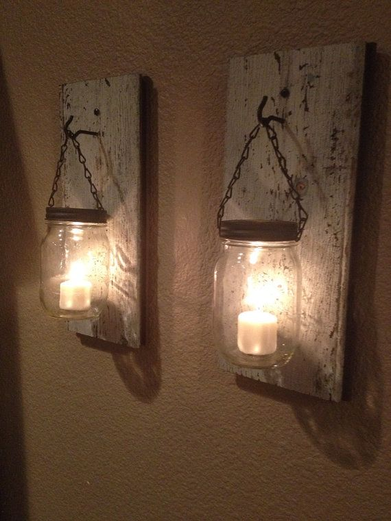 We Love These Mason Jar Candle Holders Mount Them On Wood Panelling As A Rustic Alternative To Wall Li Mason Jar Candle Holders Diy Candle Holders Candle Jars