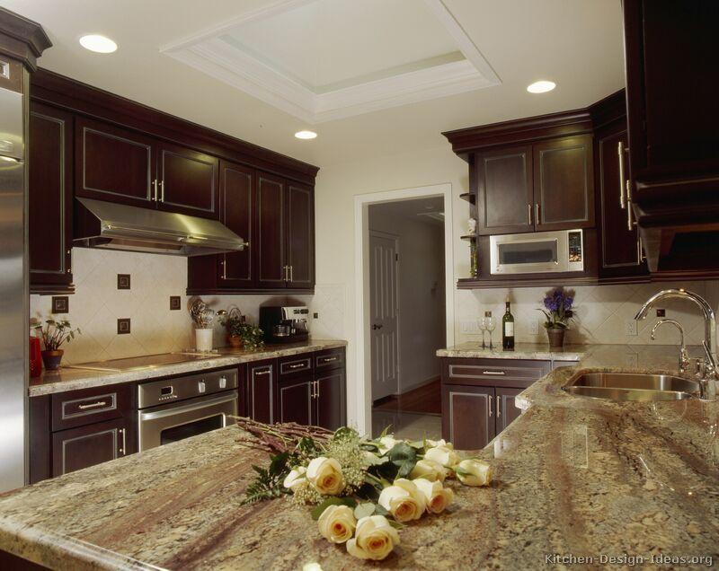 dark kitchen cabinets, striking with appliances, like mottled brown ...