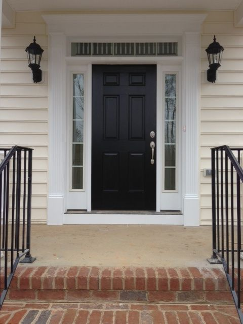 Black front door with white sidelights and white trim ...