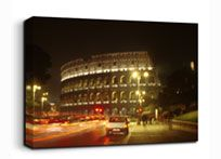The colosseum in Rome at night, one of the images you can find in our canvas art shop at photoincanvas.co.uk.    PiCx