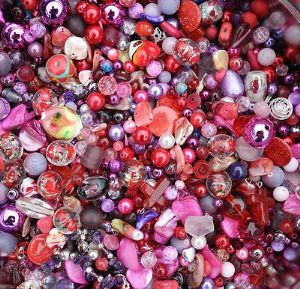 50gms of Assorted Red / Pink / Purple Beads
