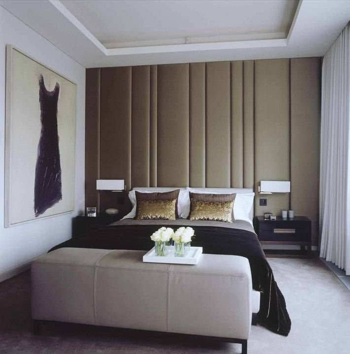 A Chic Bedroom With Incredibly Upholstered Silk Walls Is