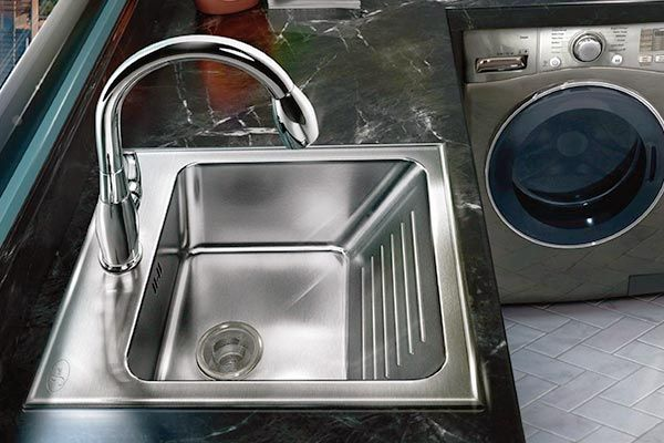 Drop in stainless steel laundry sink with built in washboard