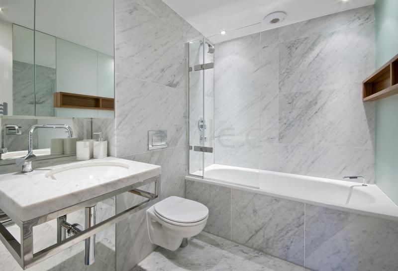 Carrara Marble Tile In A Softer Shade Of Blue Gray Shares The Gray And White Of The Calacatta Marb Marble Bathroom Carrara Marble Bathroom Marble Tile Bathroom