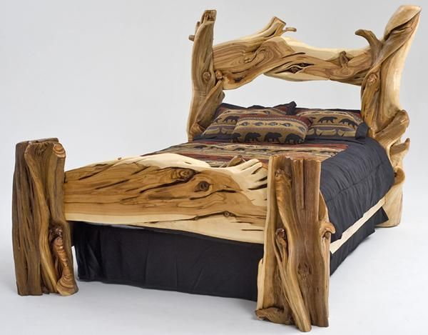 Rustic Wood Bedroom Furniture massive log posts with incredible character anchor this unique
