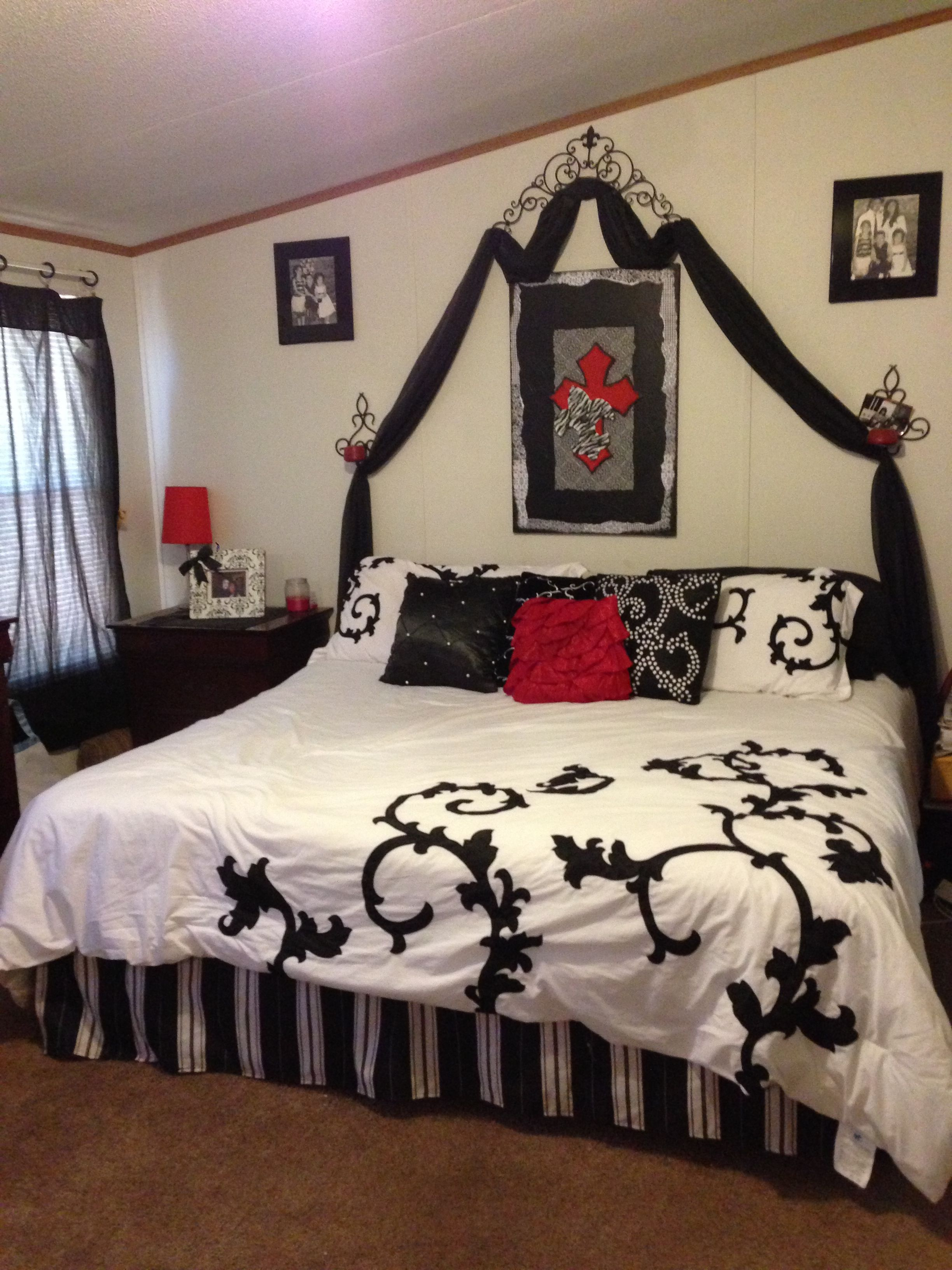 The crosses where the headboard is looks great. The red gives the room a pop of color