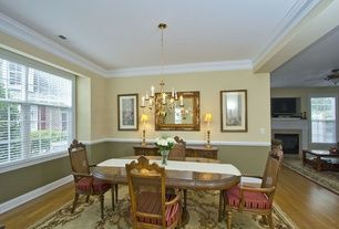 Dining Room with Hardwood floors, Carpet, Chair rail, Crown molding, Chandelier