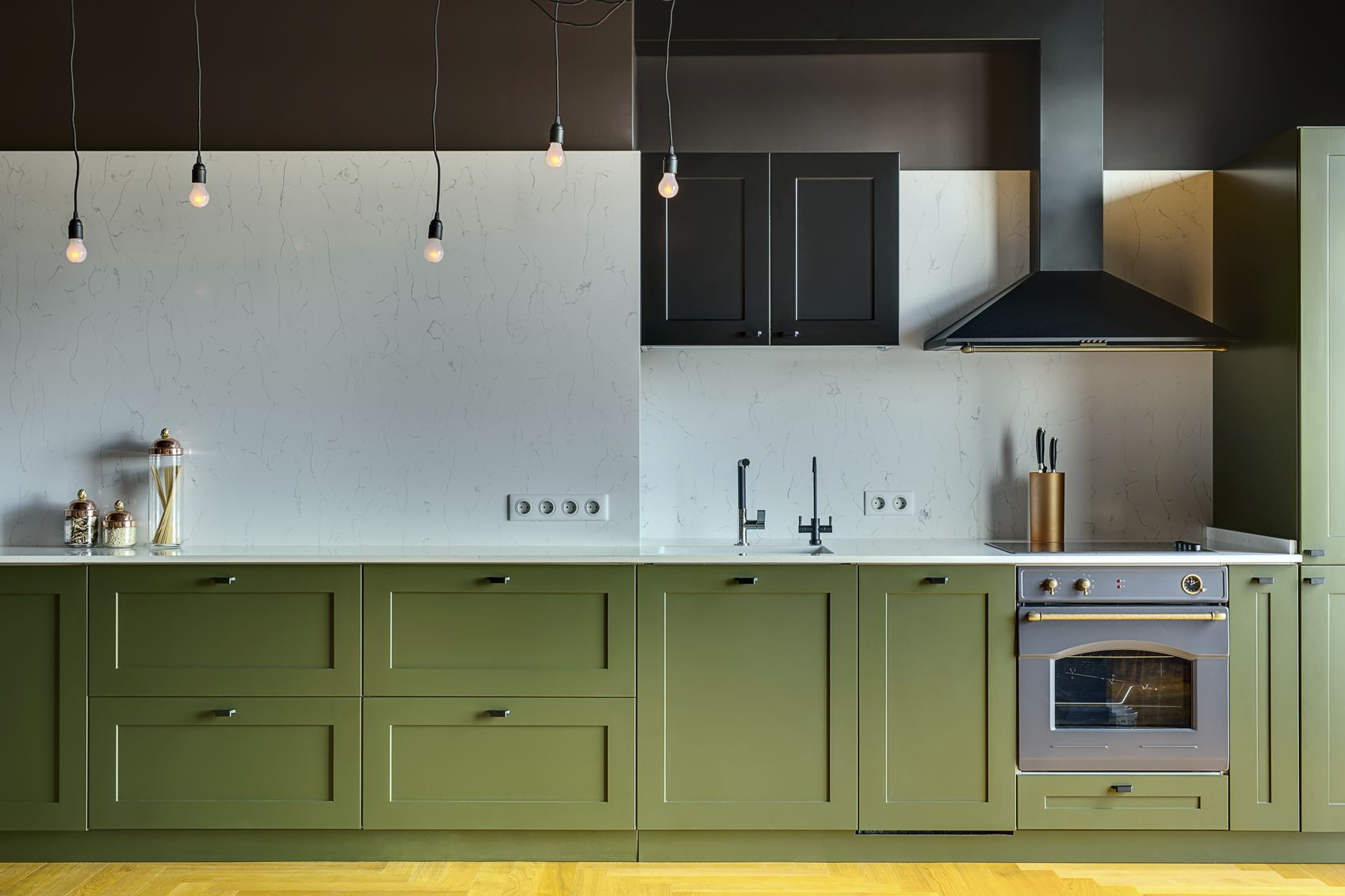 Kitchen in a modern style with a light tabletop with sink, cooker ...