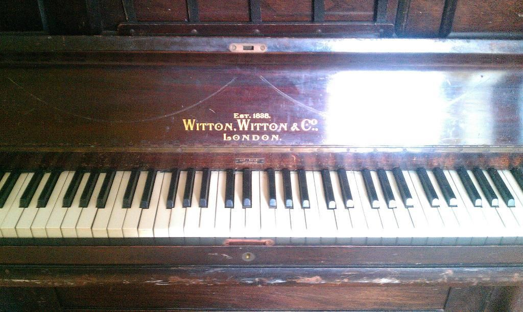 Lovely old piano looking for a new home and some tlc. It ...