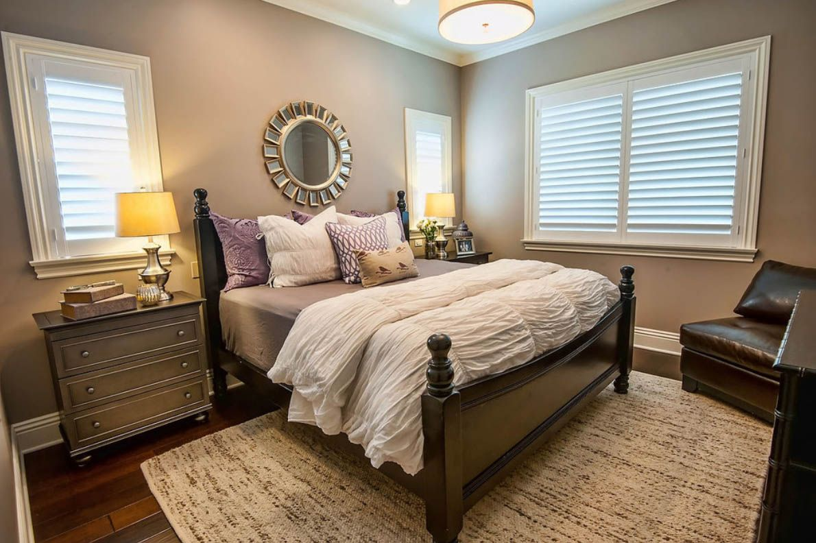 Beautiful bedroom with lilac white gray and dark wood furniture