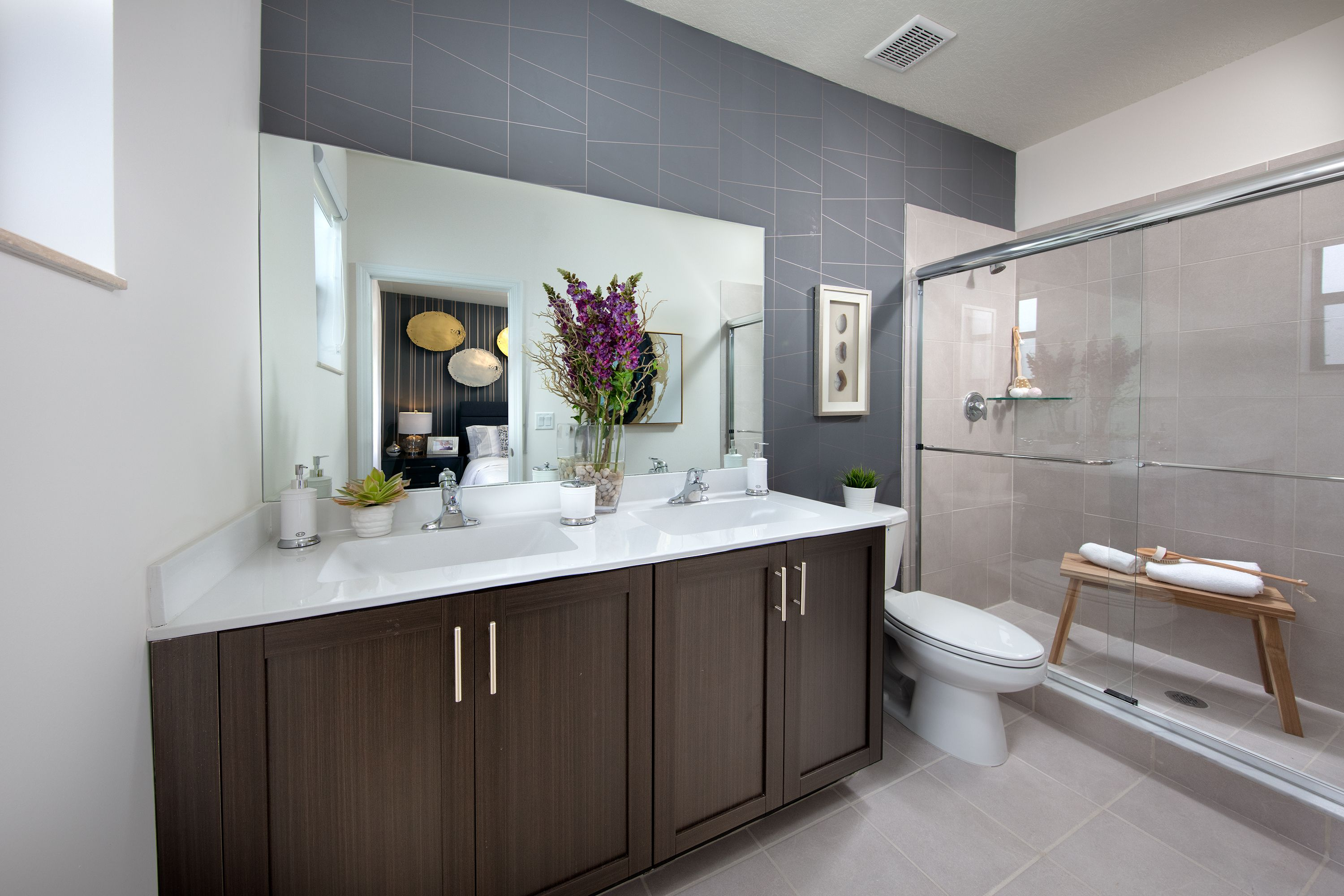 This En Suite Master Bath Boasts His And Her Sinks And A Glass Enclosed Shower While The Elegant Master Suite In 2020 New Homes His And Hers Sinks New Homes For Sale