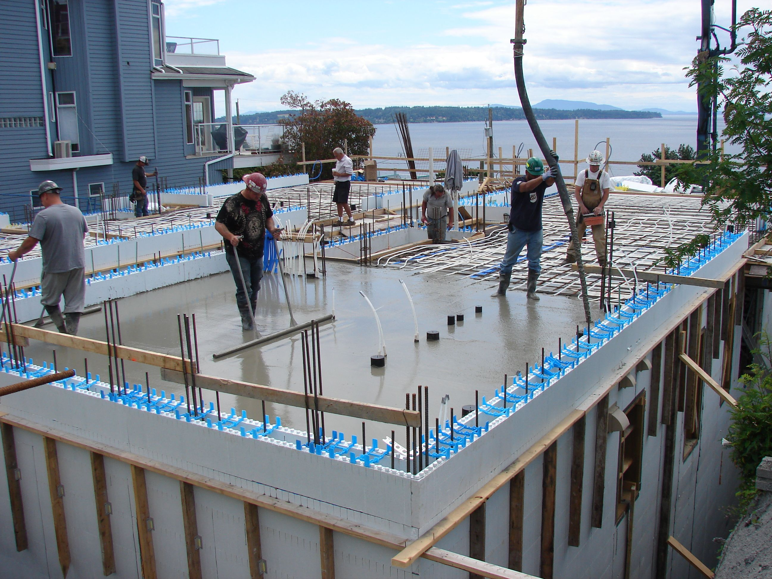 Pouring Self Consolidating Concrete On An Icf Floor Building Construction Insulated Concrete Forms Building A House