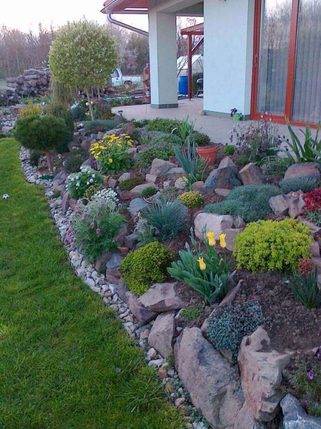 Lawn Edging Designs May Sound Like A Boring Topic You Will See There Are Some Creative And Interesting Rock Garden Design Sloped Garden Front Yard Landscaping Backyard landscaping ideas with stones