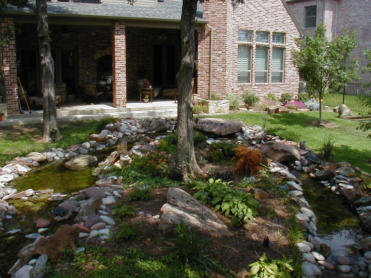 landscaping rocks under tree