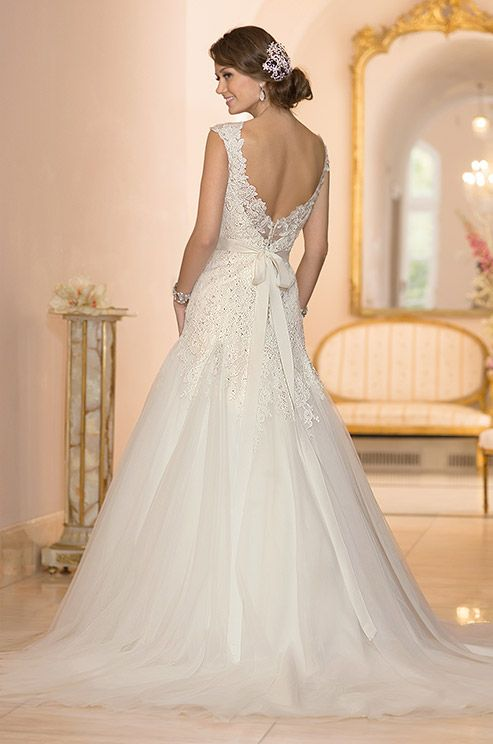 eac68e57a4 This beaded Lace and Tulle modified A-Line wedding gown features Diamante  embellishments on the fitted bodice and cap sleeves.