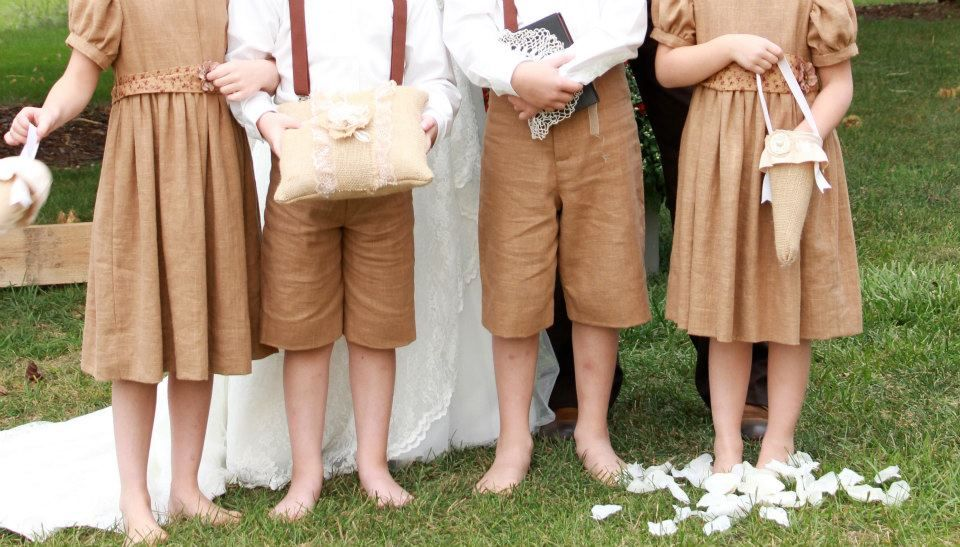 Daughters 1940's Vintage Style Wedding: Love how vintage they looked...weather perfect in Sept to allow barefeet for flower girls and ring bearers :)