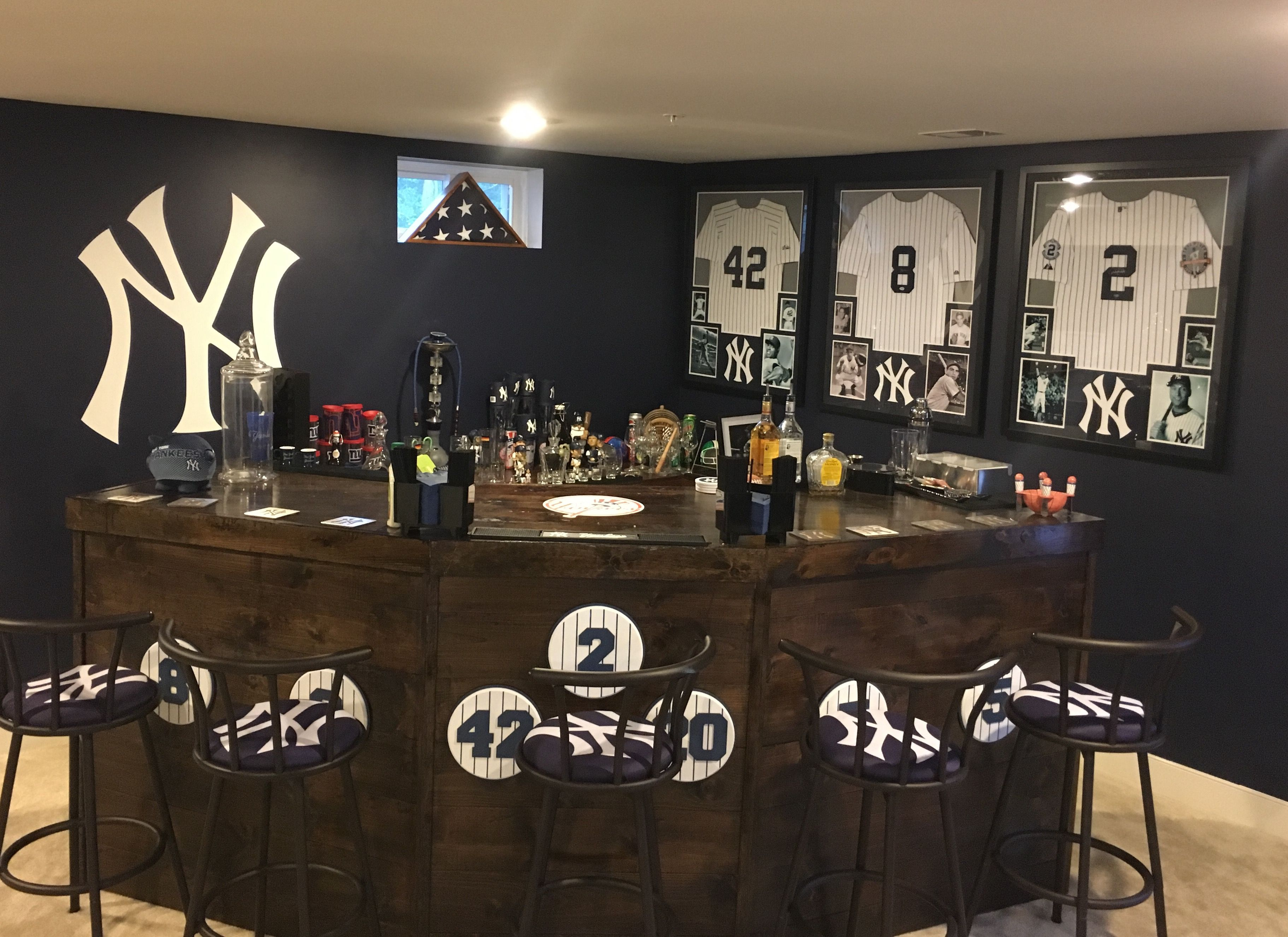 Updates To Our New York Yankees Bar Upholstered Nyy Bar Stools And Some Amazing New Autographed Jerseys Yankee Room Man Cave Home Bar Bar Room Ny yankees bathroom decor
