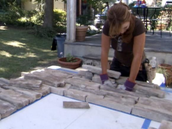 HGTV shows you how to resurface an old brick fireplace with stone and slate.